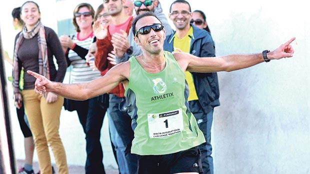 Charlton Debono acknowledges the fans' cheers at the finish in Buġibba. Photo:Wally Galea
