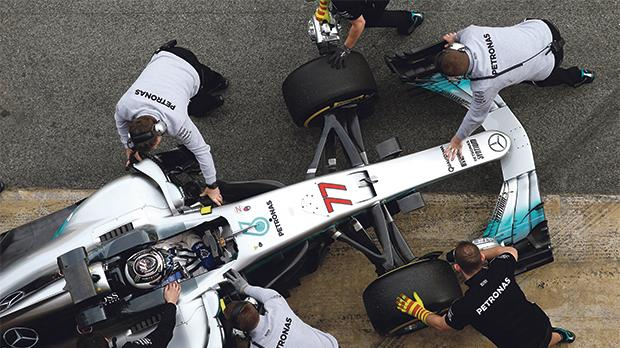 Valtteri Bottas's Mercedes racing car is pushed to the garage.