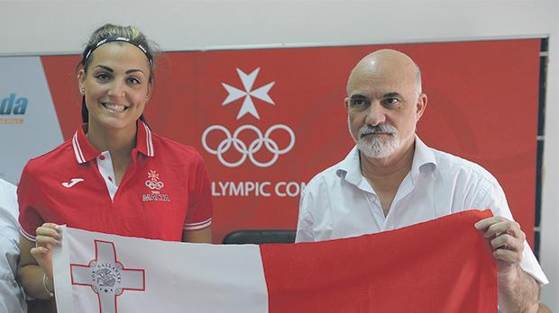 Charlotte Wingfield holds the flag along with MOCpresident Julian Pace Bonello.Photo: Matthew Mirabelli