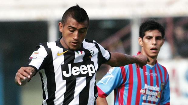 Arturo Vidal (left) scored Juventus's winner against Catania.