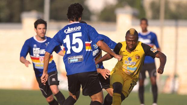 Abubakar Bello-Osagie (right) pushing forward for Qormi. Photo:Matthew Mirabelli