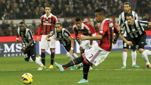 Robinho scores Milan's winner from the penalty spot, yesterday.