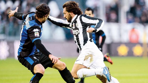Juventus midfielder Andrea Pirlo (right) sweeps past Atalanta's Ivan Radovanovic.