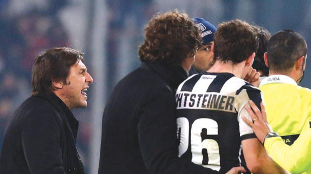 Juventus coach Antonio Conte (left) protests with the referee at the end of his side's 1-1 draw with Genoa.