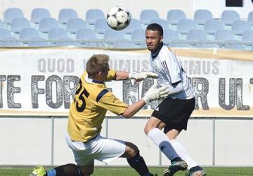 Nadur's Claudio Antunes tries to steer the ball past SK Victoria Wanderers goalkeeper Matthew Towns during last weekend's DivisionOne match. Photo: Anthony Cassar