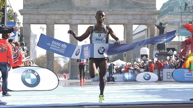 Ethiopia's Kenenisa Bekele reaches the finish line to win the Berlin Marathon, yesterday.