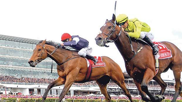 Almandin (left) wins the race ahead of Heartbreak City.