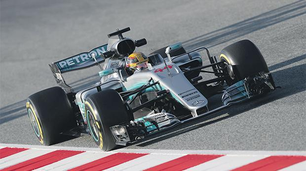 Lewis Hamilton drives his Mercedes in Barcelona, yesterday.