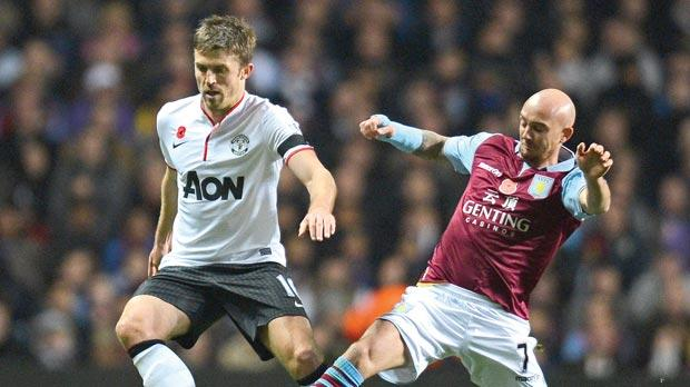 Aston Villa midfielder Stephen Ireland (right) tries to dispossess Manchester United's Michael Carrick.