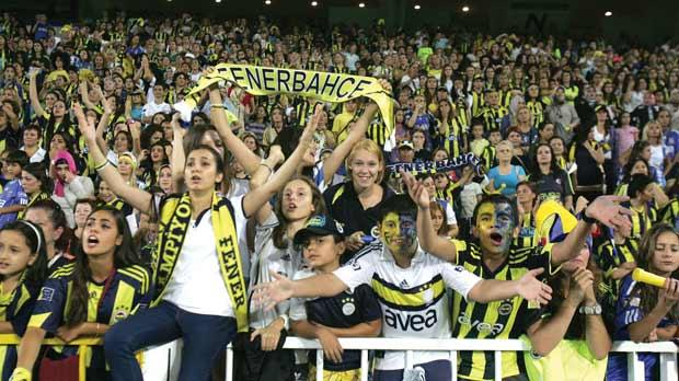 Eradicating hooliganism by banning men: some of the 41,000 Turkish women and children under 12 allowed to watch the match between Fenerbahce and Manisapor last week. Photo: AFP