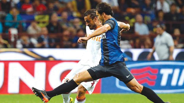 Roma striker Osvaldo powers a shot against Inter.