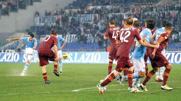 Lazio's Antonio Candreva (left) scores from a free-kick in the derby against Roma.