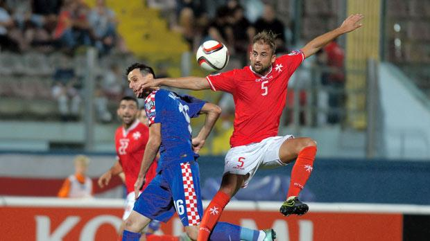 Malta defender Andrei Agius (right) tries to anticipate Croatia striker Nikola Kalinic during last Tuesday's Euro 2016 qualifier. Croatia won 1-0. Photo: Matthew Mirabelli