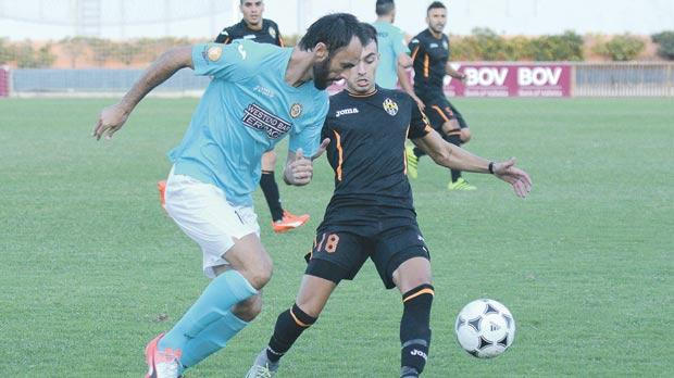 Xewkija's Daniel Bogdanovic (left) tries to go past Stefan Cassar, of Għajnsielem. Photo: Anthony Cassar