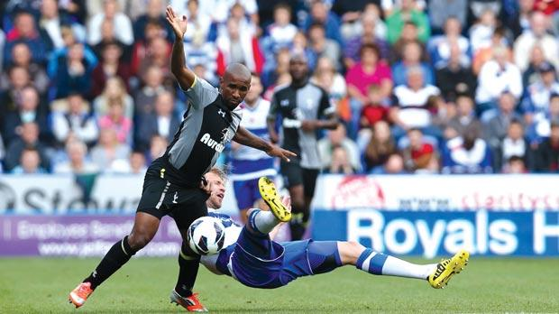 Reading's Kaspars Gorkss falls next to Jermain Defoe.