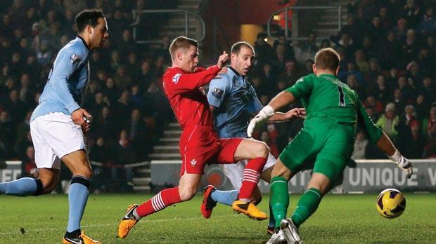 Southampton's Steven Davis (centre) scores against Manchester City.