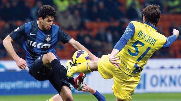 Inter's Andrea Ranocchia (left) battles for possession with Chievo's Francesco Acerbi last night.