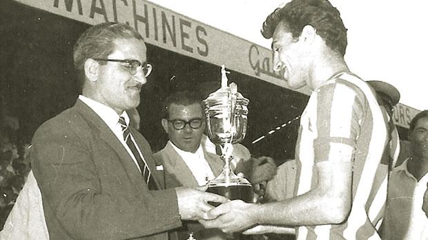 Louis Bugeja receiving the 1960 Second Division championship trophy from then Malta FA president Maurice DeCesare.