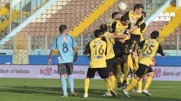 Qormi players try to block a cross during Saturday's 3-3-1 defeat to Sliema Wanderers. Photo: Jason Borg