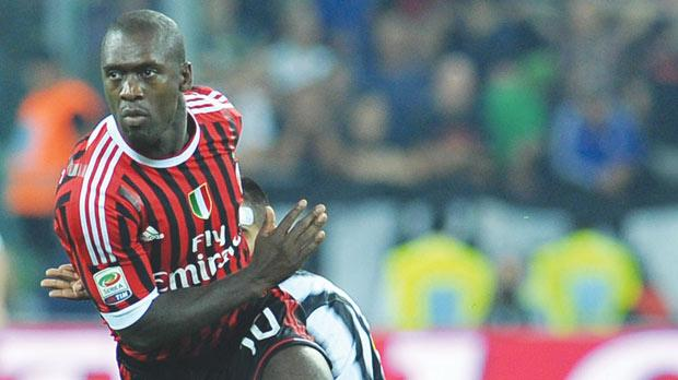 Clarence Seedorf driving Milan forward against Juventus.