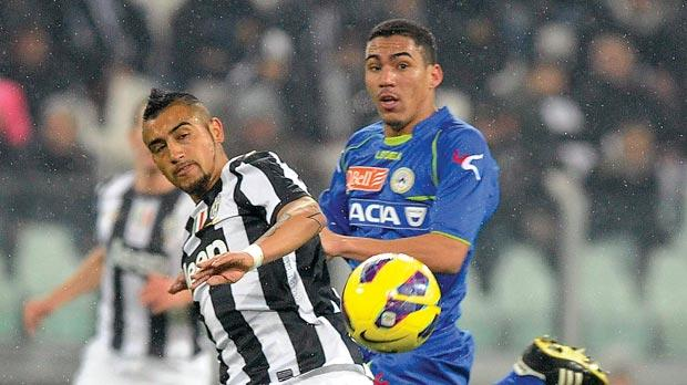 Juve's Arturo Vidal (left) challenged by Allan Marques Loureiro, of Udinese, during last weekend's Serie A match in Turin.