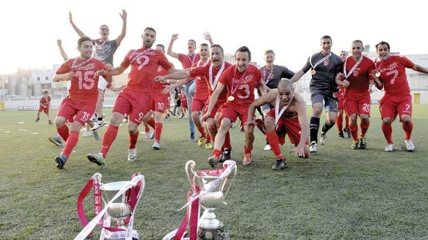 Naxxar players celebrate their win in the Division One title decider. Photo: Matthew Mirabelli