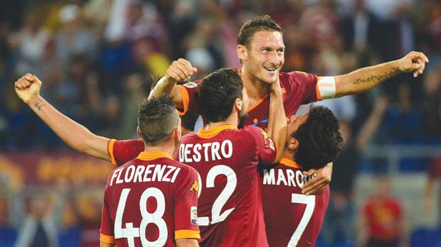 Francesco Totti is cheered by his Roma team-mates