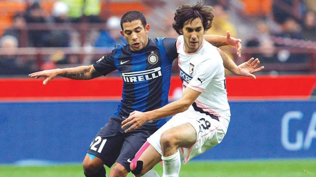 Inter's Walter Gargano closely shadows Santiago Garcia, of Palermo.