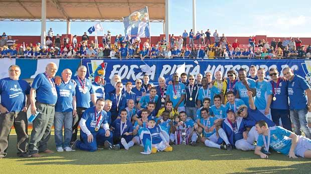 Pietà Hotspurs players and officials pose with the Division One trophy at the Centenary Stadium. Photo: Paul Zammit Cutajar