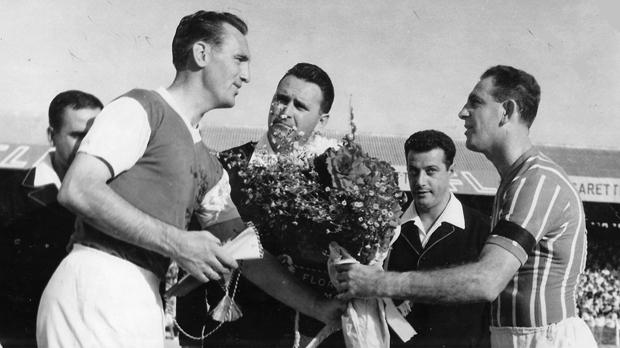 Floriana captain Pullu Demanuele (right) exchanging tokens and flowers with his Ipswich Town counterpart at the Gzira Stadium on September 18, 1962.