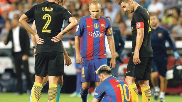 Barcelona's Lionel Messi grounded with injury at the Nou Camp, on Wednesday.