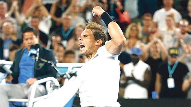 Rafa Nadal reacts after his victory over Gael Monfils, yesterday.