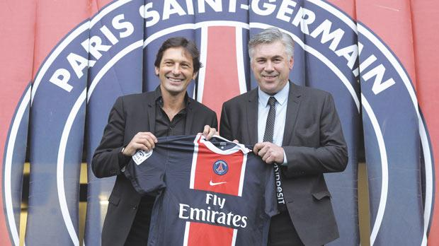 New PSG coach Carlo Ancelotti (right) with the Ligue 1's sporting director Leonardo, yesterday.