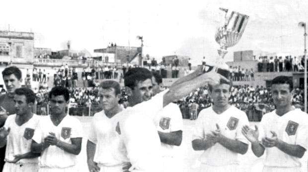Josie Urpani holds aloft the Scicluna Cup after Valletta beat rivals Floriana in the 1960-61 final.