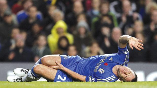 Chelsea defender John Terry down after sustaining an injury, yesterday.