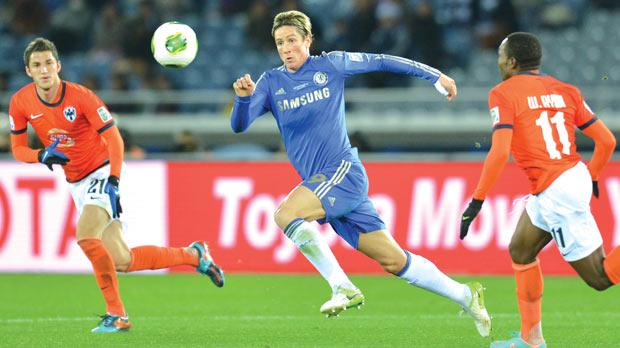 Chelsea striker Fernando Torres (right) chasing the ball against Monterrey.