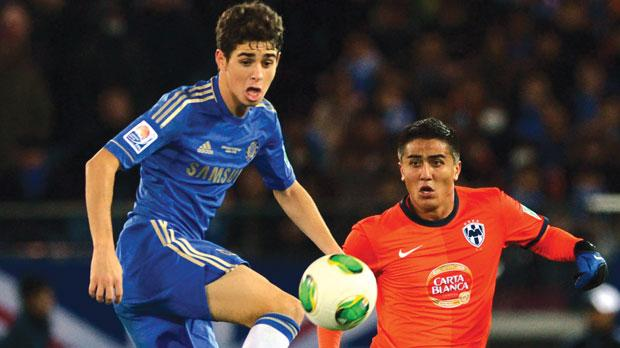 Chelsea's Oscar leaps to control the ball in front of Monterrey defender Darvin Chavez.