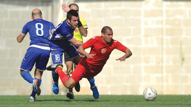Naxxar's Andre Rocha Da Silva loses his balance against Marsaxlokk. Photo: Stephen Gatt
