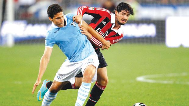 Lazio's Anderson Hernanes (left) battles for the ball with Alexandre Pato, of Milan.