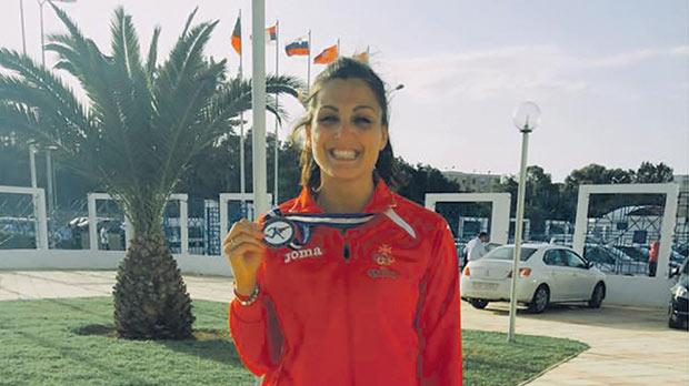 Charlotte Wingfield shows her bronze medal in Tunis.