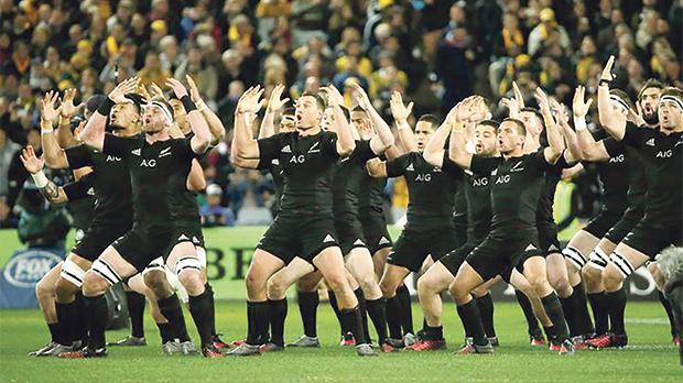 New Zealand players perform a haka.