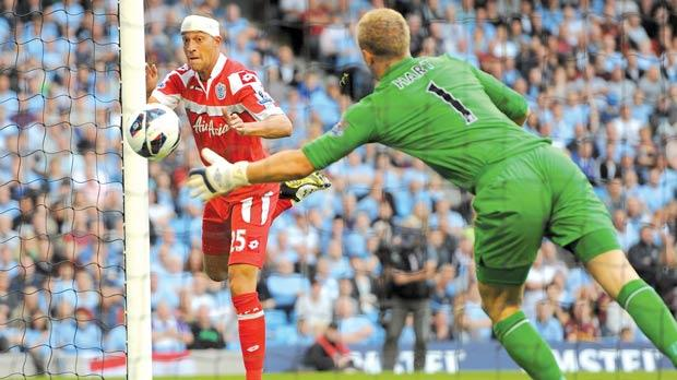 Anxious moments... Bobby Zamora scores for QPR at the Etihad Stadium.