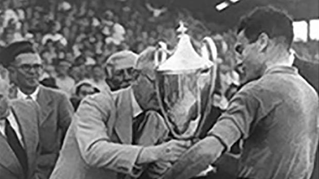 Sliema Wanderers captain Tony Nicholl receiving the Cassar Cup at the end of the 1946 final at the Empire Stadium, Gżira.