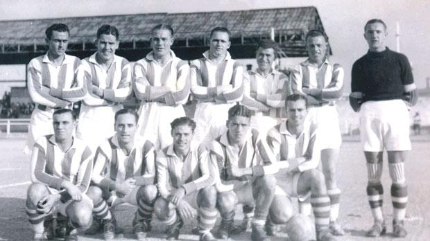 The Floriana FC squad for the 1938 Cassar Cup semi-final against the Navy team. (Back row, left to right) L. Holland (reserve), V. Miller, G. Bond, Dunne, C. Cauchi, H. Herbert, A. Swoboda. (Front) C. Friggieri, P. Storace, E. Cauchi, S. Vickers, F. Tabone.