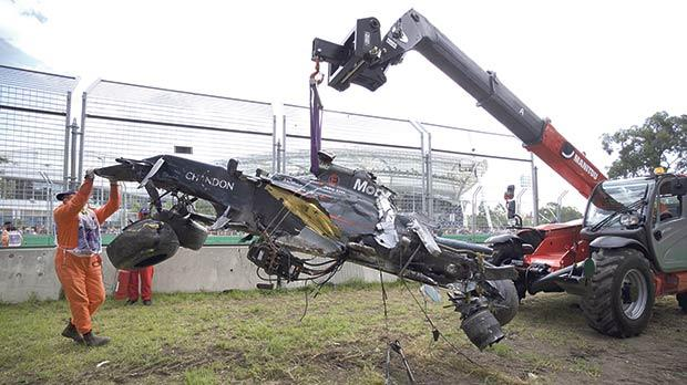 The wrecked McLaren of Spaniard Fernando Alonso is retrieved following a crash at the Australian GP earlier this season.