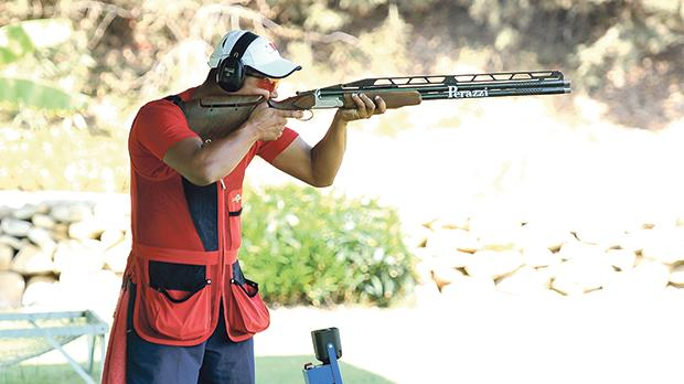 William Chetcuti taking aim during a double trap shoot.