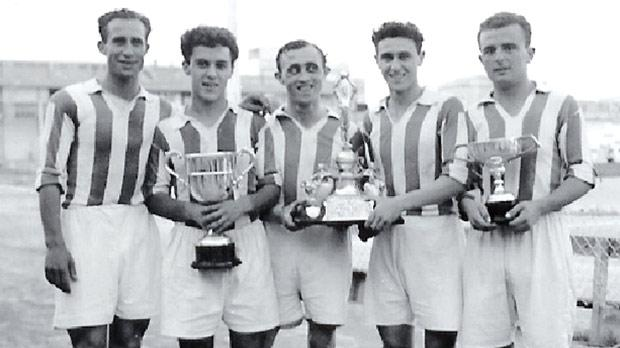 Leli Zammit (left) celebrating with Benny Camilleri, Harold Herbert, Lolly Borg and Lolly Debattista after winning one of his four FA Trophy medals with Floriana.