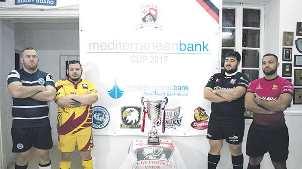 Players of Overseas, Falcons, Kavallieri and Stompers pose with the Mediterranean Bank Cup at the MRFU clubhouse. Photo: Ian Stilon