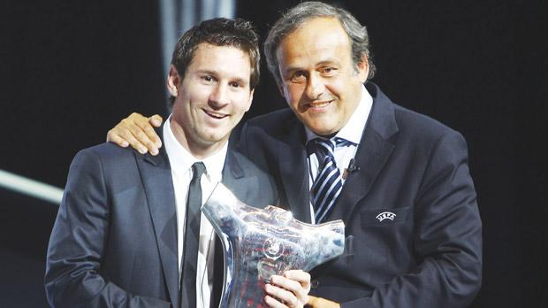 UEFA president Michel Platini (right) with Lionel Messi who last week was voted best player in Europe for 2010-11.