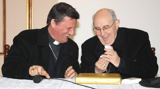 Cardinal Agostino Vallini (right) and Gozo Bishop Mario Grech exchanging gifts at Ta' Pinu sanctuary.